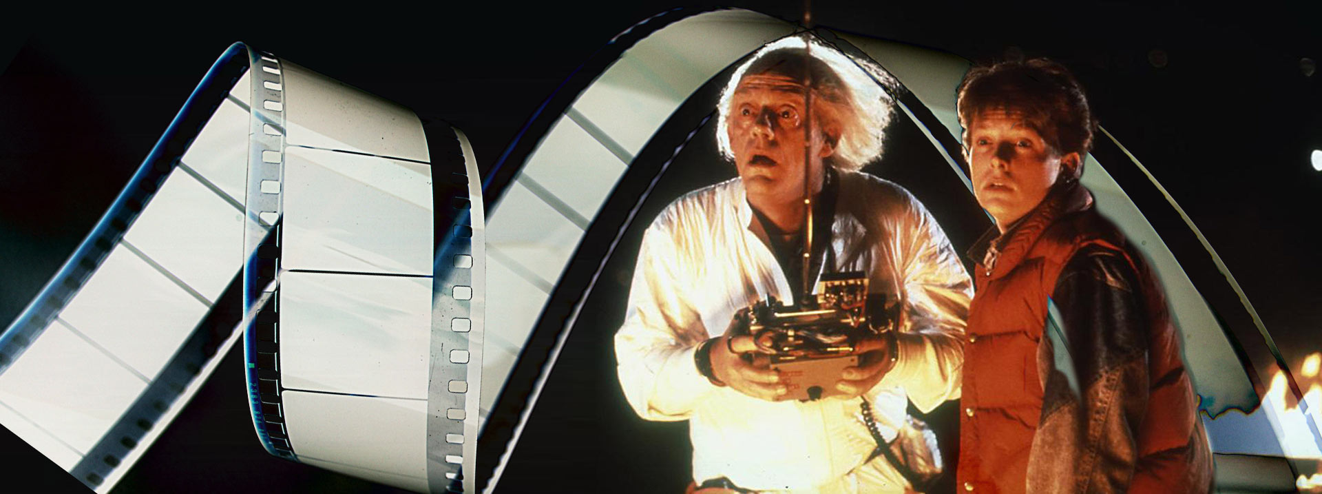 Dr. Emmet Brown and Marty McFly in Back To the Future with Film Reel flowing around them